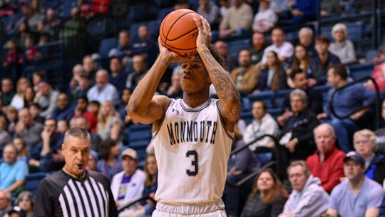 Monmouth's Deion Hammond launches a shot during the Hawks' victory over Iona on Sunday at OceanFirst Bank Center in West Long Branch.