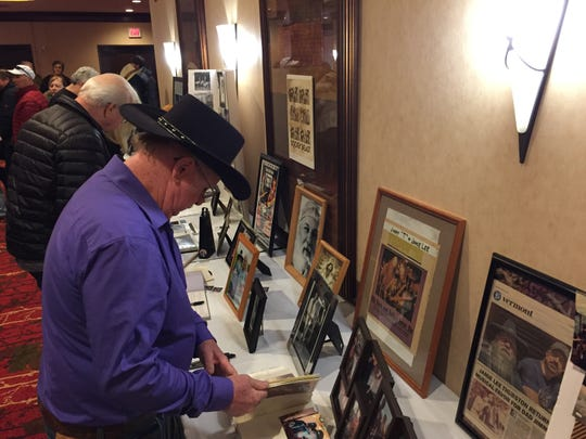 Fans look at a display from the career of Jimmy T Thurston at a celebration of the late Vermont musician's life Jan. 5, 2020 at the Hilton in Burlington.