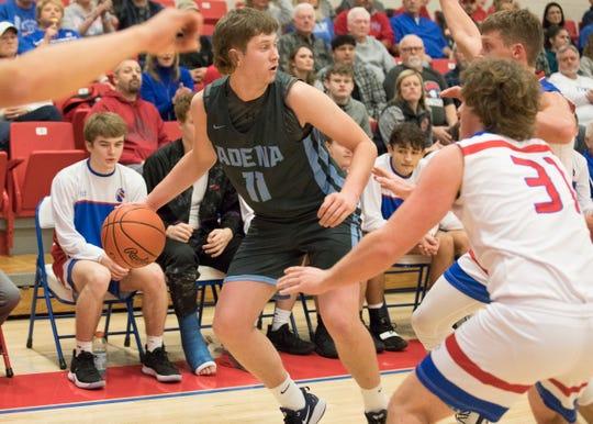 Adena's Logan Bennett dribbles the ball along the perimeter during a 60-44 loss to Zane Trace at Zane Trace High School.