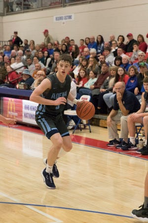 Adena's Dillon McDonald dribbles the ball along the perimeter during a game against Zane Trace at Zane Trace High School.