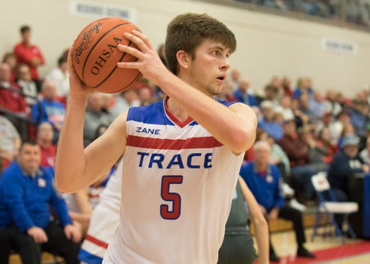 Zane Trace big man Nick Nesser grabs the ball during a 60-44 win over Adena Saturday night at Zane Trace High School.