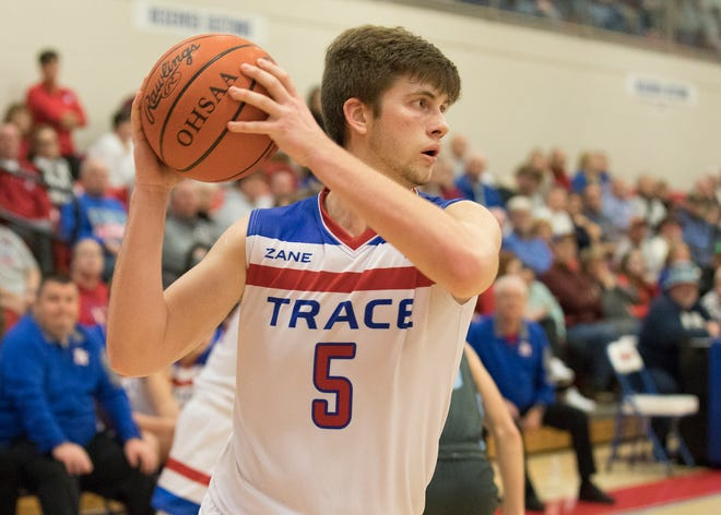 Zane Trace big man Nick Nesser looks to pass during a 60-44 win over Adena at Zane Trace High School on Jan. 4, 2020.