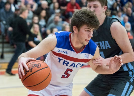Zane Trace big man Nick Nesser dribbles the ball in the post during a 60-44 win over Adena at Zane Trace High School.