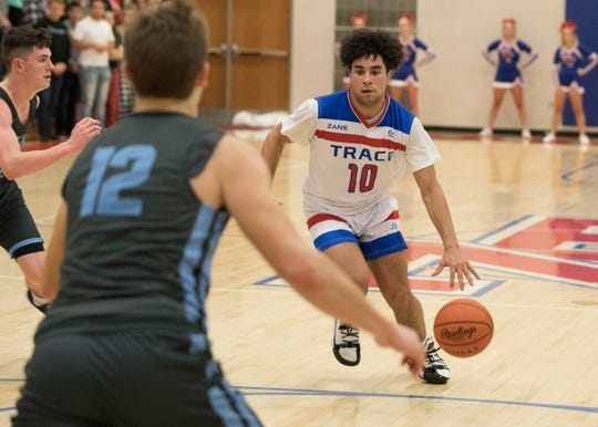 Zane Trace guard Cam Evans dribbles the ball during a 60-44 win over Adena at Zane Trace High School.