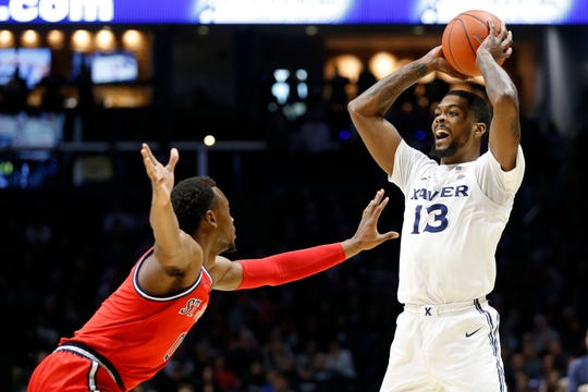 Xavier Musketeers forward Naji Marshall (13) looks for a pass in the first half of the NCAA Big East game between the Xavier Musketeers and the St. John's Red Storm at the Cintas Center in Cincinnati on Sunday, Jan. 5, 2020. Xavier led 34-32 at halftime.