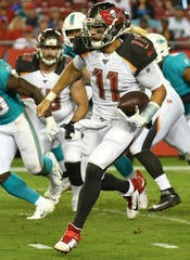 Aug 16, 2019; Tampa, FL, USA; Tampa Bay Buccaneers quarterback Blaine Gabbert (11) runs the ball in the first half  against the Miami Dolphins at Raymond James Stadium.
