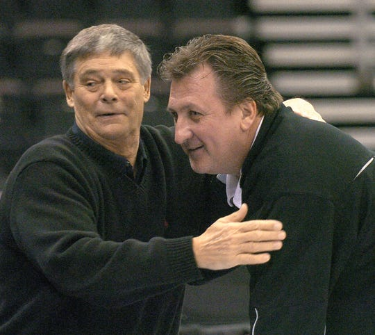 JANUARY 1, 2007: University of Cincinnati Basketball broadcaster Chuck Machock, left, hugs Bob Huggins. Former University of Cincinnati Basketball Coach Bob Huggins returned to Cincinnati for practice with his Kansas State team in preparation for an upcoming game with Xavier University at US Bank Arena.