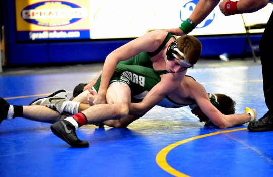 Pierce Taylor (top) of McNicholas scores a tech fall win for the first-place medal in the 132-pound class over Batavia's Brennan Bruner at the 2020 Bob Kearns Madeira Wrestling Invitational Tournament, Jan. 4, 2020.