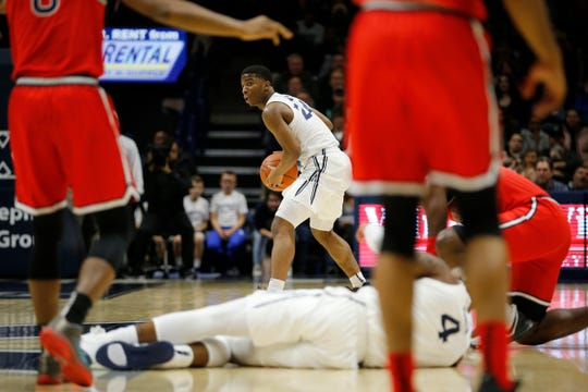 Xavier Musketeers guard KyKy Tandy (24) takes control of a loose ball in the first half of the NCAA Big East game between the Xavier Musketeers and the St. John's Red Storm at the Cintas Center in Cincinnati on Sunday, Jan. 5, 2020. Xavier led 34-32 at halftime.
