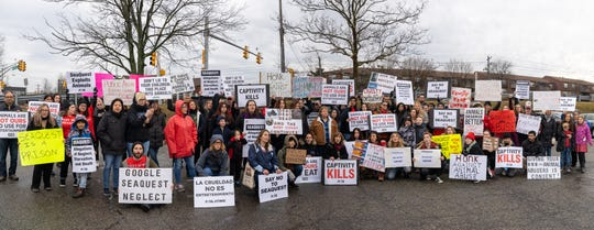 More than 100 activists met outside the Woodbridge Center on Saturday demanding a common goal: shut down the SeaQuest at Woodbridge Center.