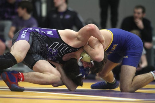 Norwalk's Landon Card and Martensdale-St. Mary's Dominick Dicesare grapple in a 138-pound match. Card won an 8-6 sudden victory. Indianola hosted the Warren County Duals on Jan. 4.