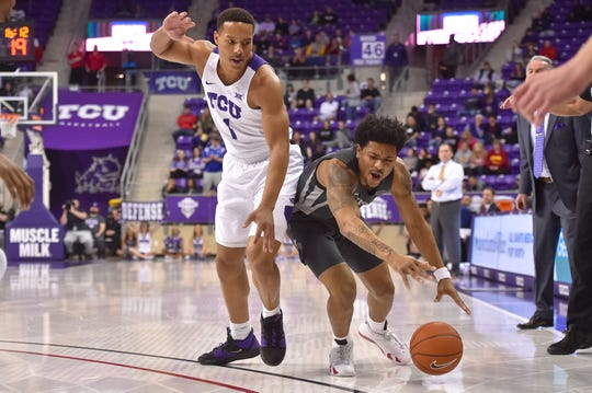 Jan 4, 2020; Fort Worth, Texas, USA; TCU Horned Frogs guard Desmond Bane (1) fouls Iowa State Cyclones guard Prentiss Nixon (11) during the first half at Ed and Rae Schollmaier Arena. Mandatory Credit: Tim Flores-USA TODAY Sports