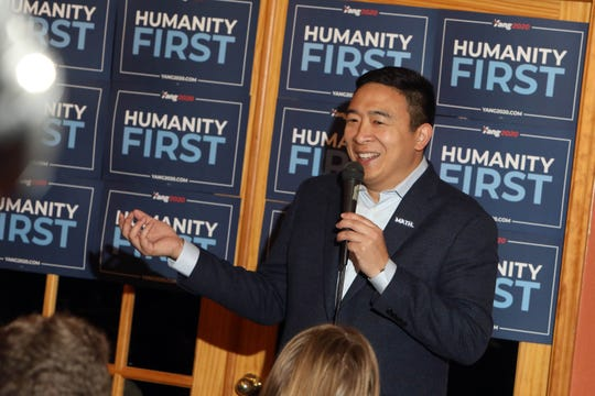 Democratic presidential candidate Andrew Yang speaks during a meet-and-greet campaign event with his wife, Evelyn Yang, on Saturday, Jan. 4, 2020, at the Central Park Coffee Company in Mount Pleasant, Iowa. The stop was part of Yang's four-day tour through southeast Iowa.