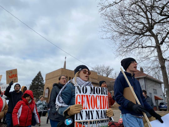 Anti-war activists take to the streets of Des Moines on Jan 5, 2020 protesting Trump's recent actions against Iran.