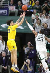 Michigan State forward Xavier Tillman defends against Michigan forward Brandon Johns Jr. during the second half of MSU's 87-69 win over U-M on Sunday, Jan. 5, 2020, in East Lansing.