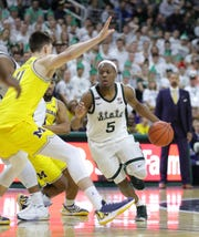 Michigan State guard Cassius Winston drives against Michigan forward Colin Castleton during the second half of MSU's 87-69 win Sunday, Jan. 5, 2020, in East Lansing.