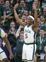 Michigan State guard Cassius Winston is all smiles after hitting a 3-pointer during the second half of MSU's 87-69 win over U-M on Sunday, Jan. 5, 2020, in East Lansing.