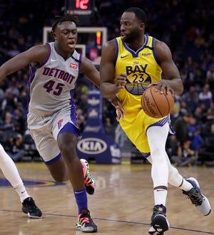 Golden State Warriors' Draymond Green drives against Detroit Pistons' Sekou Doumbouya on Jan. 4, 2020, in San Francisco.