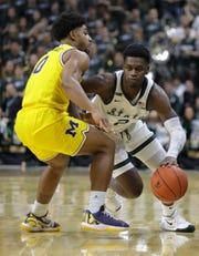 Michigan State guard Rocket Watts drives against Michigan guard David DeJulius during the second half  of MSU's 87-69 win over U-M on Sunday, Jan. 5, 2020, in East Lansing.