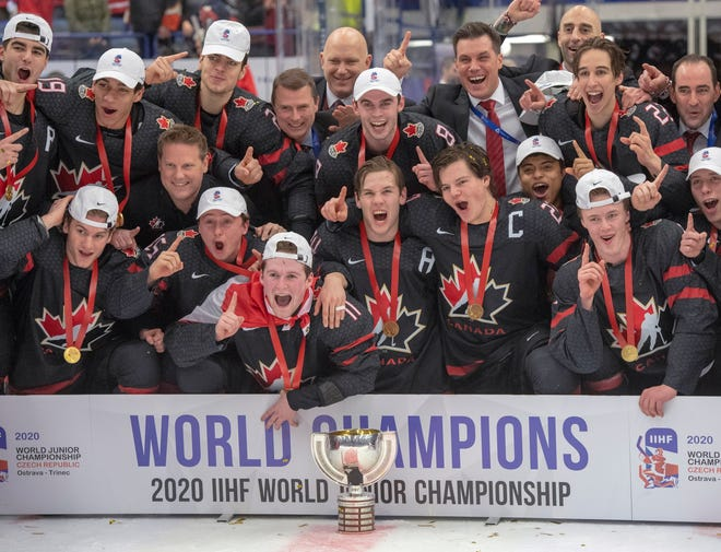 Team Canada celebrates after defeating Russia in the gold medal game at the World Junior Hockey Championships, Sunday, Jan. 5, 2020 in Ostrava, Czech Republic.