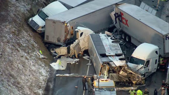 A bus was first struck by two tractor-trailers, then another truck and a passenger car.