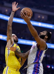 Detroit Pistons' Andre Drummond, right, lays up a shot against Golden State Warriors' Willie Cauley-Stein during the first half.
