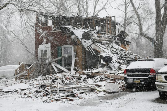 Wreckage is strewn across the property of a home on the 14400 block Evergreen in Detroit on Sunday after what is believed to be a gas explosion at the home on Saturday.  Six victims between the ages of 23 and 39 were hospitalized, fire authorities said.