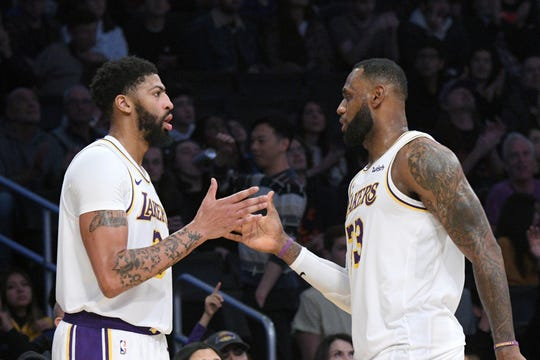 LeBron James (right) is leading the NBA in assists per game, and has been helped by the offseason addition of Anthony Davis (left).