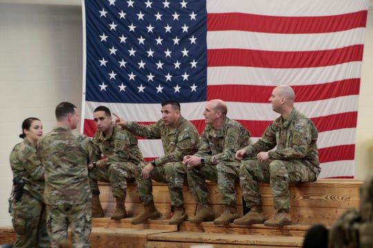 U.S. Army soldiers wait before heading out Saturday, Jan. 4, 2020 at Fort Bragg, N.C., as troops from the 82nd Airborne are deployed to the Middle East as reinforcements in the volatile aftermath of the killing of Iranian Gen. Qassem Soleimani.