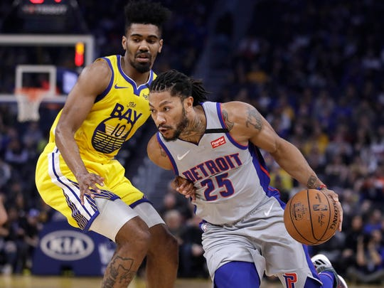 Detroit Pistons' Derrick Rose, right, drives the ball against Golden State Warriors' Jacob Evans (10) during the first half.