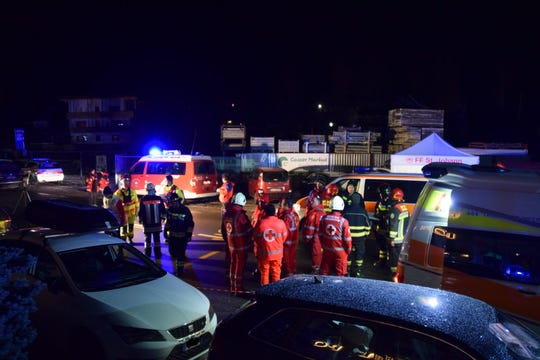 Emergency services of the Luttach voluntary fire brigade secure an accident site after a car drove into a group of people crossing a road in Luttach, near Bruneck in the northern region South Tirol, Italy, on early Sunday, Jan. 5, 2020.