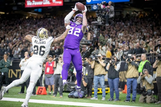 Minnesota Vikings tight end Kyle Rudolph catches the winning touchdown over New Orleans Saints cornerback P.J. Williams in overtime on Sunday at Mercedes-Benz Superdome in New Orleans, La.
