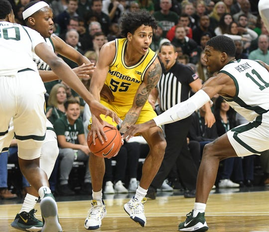Michigan's Eli Brooks was 0-for-4 on 3-pointers on Sunday.