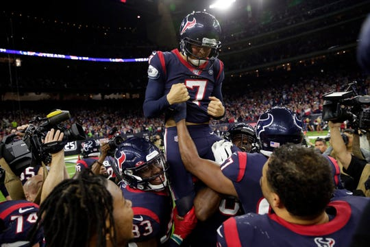 Houston Texans kicker Ka'imi Fairbairn (7) celebrates with teammates after kicking the winning field goal against the Buffalo Bills during overtime of an AFC wild-card playoff game Saturday. The Texans won 22-19.
