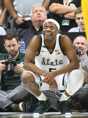 Michigan State's Cassius Winston looks up to the video boards to see it he had put up a shot before being fouled on a drive in the second half.
