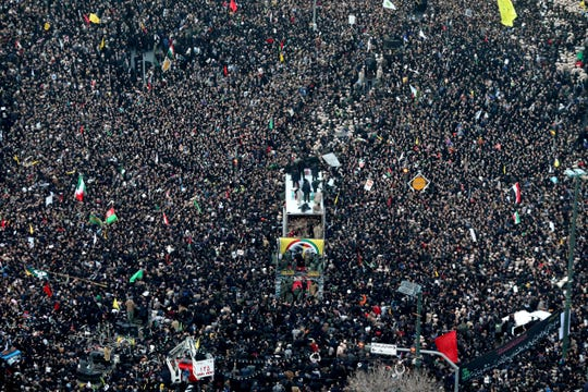 Coffins of Gen. Qassem Soleimani and others who were killed in Iraq by a U.S. drone strike, are carried on a truck surrounded by mourners during a funeral procession, in the city of Mashhad, Iran, Sunday, Jan. 5, 2020.