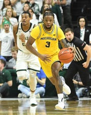 Michigan's Zavier Simpson leads the nation with 8.9 assists per game.