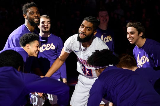 Evansville's K.J. Riley (33) is surrounded by his teammates before the start of the home game against the Valparaiso Crusaders at Ford Center in Evansville, Ind., Saturday, Jan. 4, 2020. The Purple Aces fell 81-79 to the Crusaders in overtime.