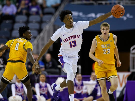 Evansville's DeAndre Williams (13) gains control of the ball and drives down the court during the second half against the Valparaiso Crusaders at Ford Center in Evansville, Ind., Saturday, Jan. 4, 2020. The Purple Aces fell 81-79 to the Crusaders in overtime.