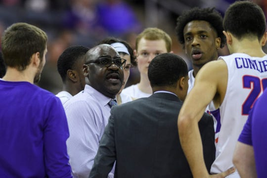 Bennie Seltzer, University of Evansville's interim head coach, talks to his team during the second quarter against the Valparaiso Crusaders at Ford Center in Evansville, Ind., Saturday, Jan. 4, 2020. The Purple Aces fell 81-79 to the Crusaders in overtime.