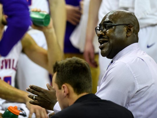 Bennie Seltzer, University of Evansville's interim head coach, talks to the team during a media timeout in the first half against the Valparaiso Crusaders at Ford Center in Evansville, Ind., Saturday, Jan. 4, 2020.