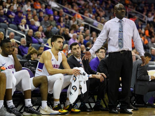Evansville's Sam Cunliffe (20) cools off on the bench as Bennie Seltzer, University of Evansville's interim head coach, attempts to calm the team down during the first half against the Valparaiso Crusaders at Ford Center in Evansville, Ind., Saturday, Jan. 4, 2020. The Purple Aces fell 81-79 to the Crusaders in overtime.