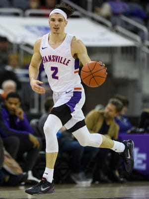 Evansville's Artur Labinowicz (2) drives down the court during the first half against the Valparaiso Crusaders at Ford Center in Evansville, Ind., Saturday, Jan. 4, 2020. The Purple Aces fell 81-79 to the Crusaders in overtime.