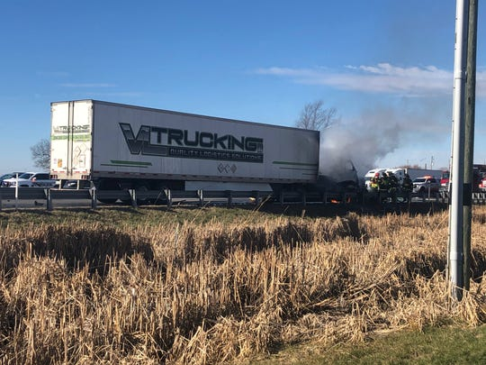 A semi is engulfed in flames at the scene of a fatal multi-vehicle crash on I-65 in Boone County at 11:05 a.m. Sunday, Jan. 5, 2020.