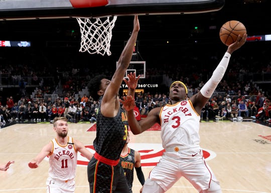 Indiana Pacers guard Aaron Holiday (3) attempts a shot against Atlanta Hawks center Damian Jones (30) in the first half at State Farm Arena.