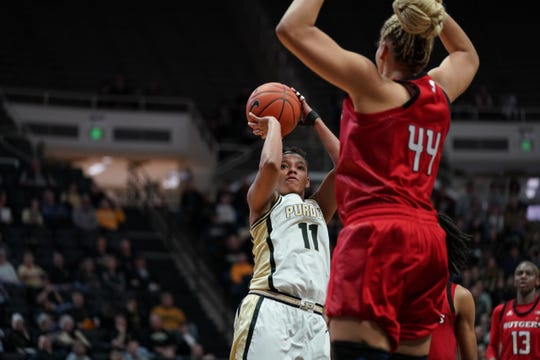 Purdue's Dominique Oden shoots over Rutgers center Jordan Wallace on Sunday at Mackey Arena