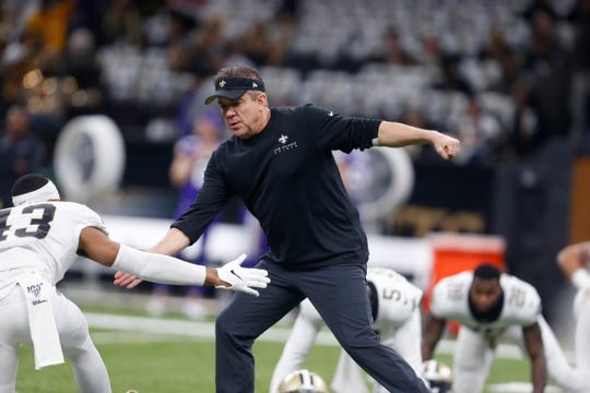 New Orleans Saints head coach Sean Payton greets free safety Marcus Williams (43) before an NFL wild-card playoff football game against the Minnesota Vikings, Sunday, Jan. 5, 2020, in New Orleans. (AP Photo/Butch Dill)