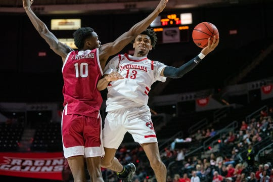 UL's Mylik Wilson challenges a defender while going up to the goal as the Ragin' Cajuns beat Troy on Saturday.