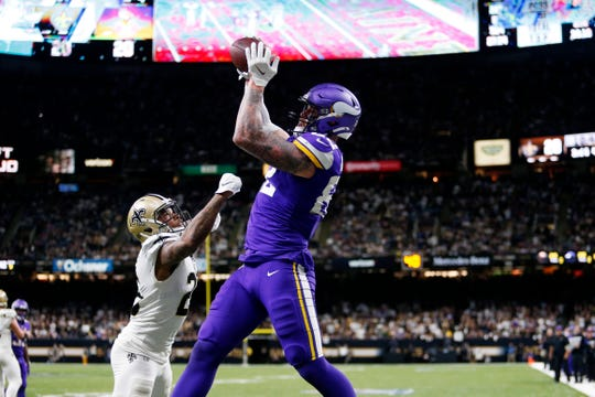 Minnesota Vikings tight end Kyle Rudolph pulls in the game winning touchdown pass over New Orleans Saints cornerback P.J. Williams during overtime of an NFL wild-card playoff football game, Sunday, Jan. 5, 2020, in New Orleans. The Vikings won 26-20. (AP Photo/Brett Duke)