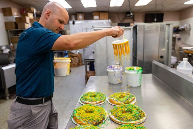Twins Burgers and Sweets Co-Owner Denny Guilbeaux preparing King Cakes for Mardi Gras customers.